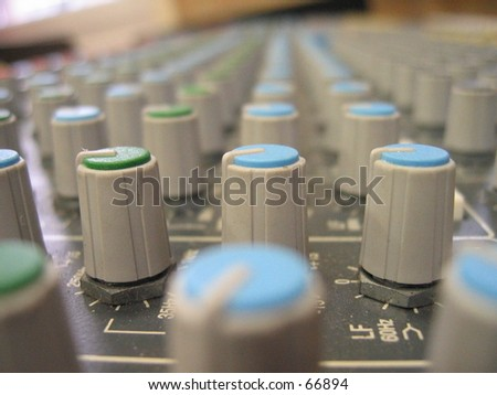 Pan adjusters on mixing board. - stock photo
