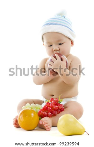 Pan Asian baby playing with fruits on white background - stock photo