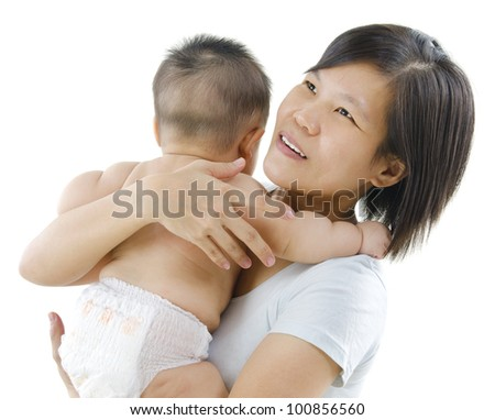 Pan Asian mother pampering her baby boy on white background - stock photo