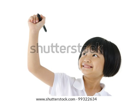 Pan Asian schoolgirl writing on blank space - stock photo