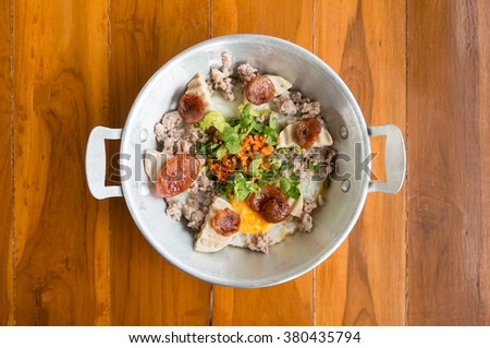 pan-fried egg with pork and toppings, Breakfast food in Thai style - stock photo