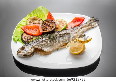 Golden trout stock photos royalty free images vectors for Pan grilled fish