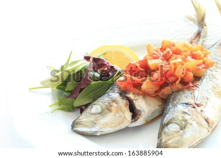Pan fried horse mackerel with tomato and celery Balsamic vinegar sauce - stock photo