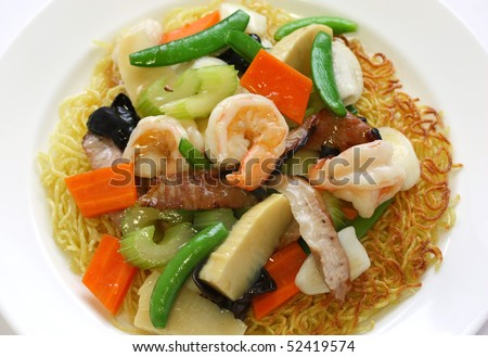 Pan fried noodles with seafood - stock photo