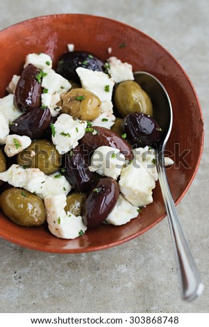 Pan-Fried Olives and Feta. Shallow Depth of Field. - stock photo