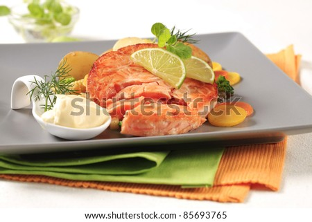 Pan fried salmon with potatoes and mixed vegetables - stock photo