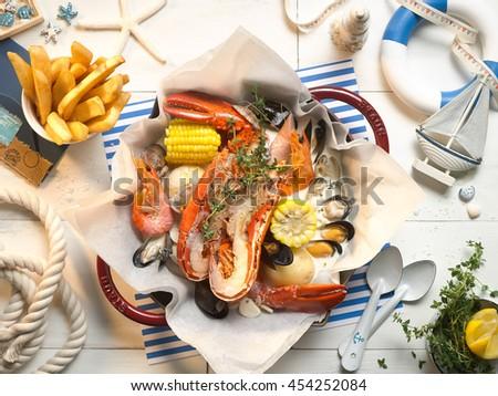 Pan of lobsters mussels clams shrimp in marine ocean style - stock photo