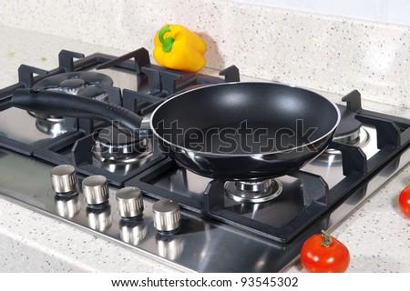 pan on the stove - stock photo