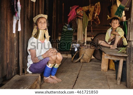 Pan Pet, Myanmar - May 25, 2016: Senior woman from Padaung (Karen) hill tribe sitting with child near the own house, Myanmar