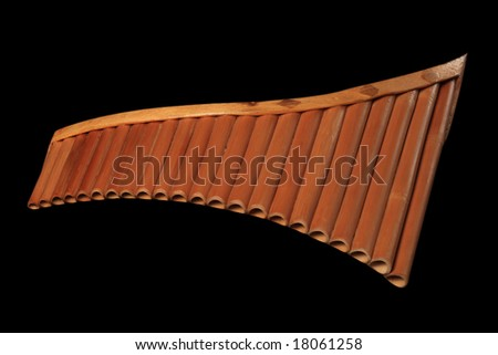 Pan pipe - isolated on black background - stock photo