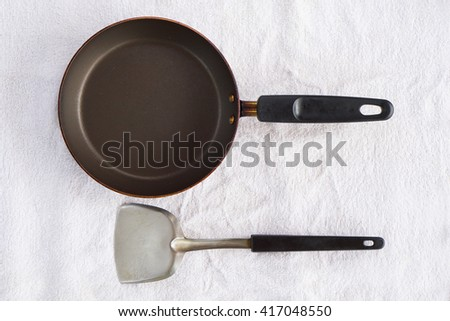 Pan with handle and Spade of frying pan on white background - stock photo