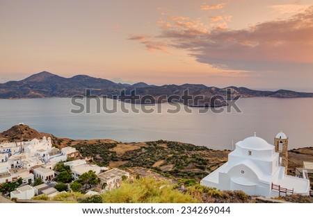 Panagia Thalassitra church and Plaka village at sunset, Milos island, Cyclades, Greece. - stock photo