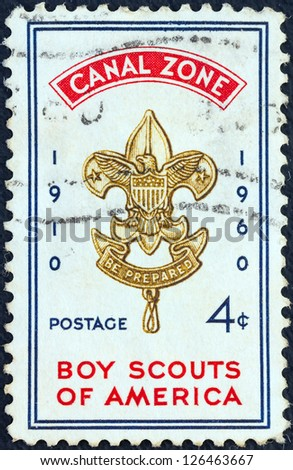 PANAMA CANAL ZONE- CIRCA 1960: A stamp printed in Panama Canal Zone issued for the the 50th anniversary of Boy Scouts of America shows emblem, circa 1960.