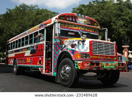 PANAMA CITY - CIRCA DECEMBER 2012: Brightly decorated local bus in city streets - stock photo
