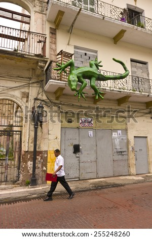 PANAMA CITY, PANAMA - AUGUST 10, 2009: Street scene and lizard sculpture, in Casco Viejo, historic city center. - stock photo