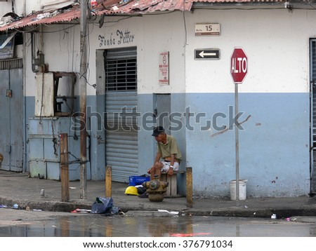 PANAMA CITY/PANAMA - 19 FEBRUARY 2012: An old man sitting on a street of Casco Viejo. In Panama social differences are high, and poverty is one of the main problems of Casco Viejo