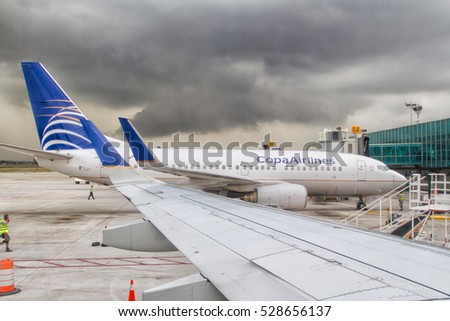 PANAMA CITY, PANAMA - MAY 8, 2014: Copa Airlines plane parks at the gate ready for boarding