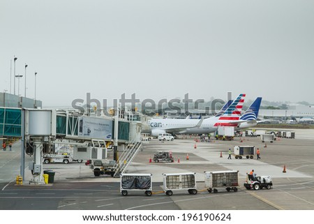 PANAMA CITY, PANAMA - MAY 08: Plane parks at the gate in Panama City airport, Panama, Central America on May 08, 2014. Panama City airport is the main hub in Central America - stock photo