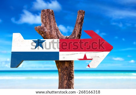 Panama Flag wooden sign with beach background - stock photo
