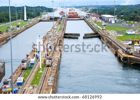 PANAMA - OCTOBER 6. In July 2009, the Panama Canal Authority awarded contracts to a consortium of companies to build six new locks by 2015. Existing canal seen from a ship. October 6, 2010, Panama - stock photo