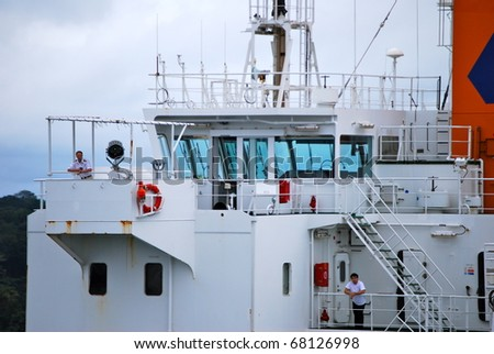 PANAMA - OCTOBER 6. In July 2009, the Panama Canal Authority awarded contracts to a consortium of companies to build six new locks by 2015. Ship's pass each other at Balboa. October 6, 2010, Panama - stock photo