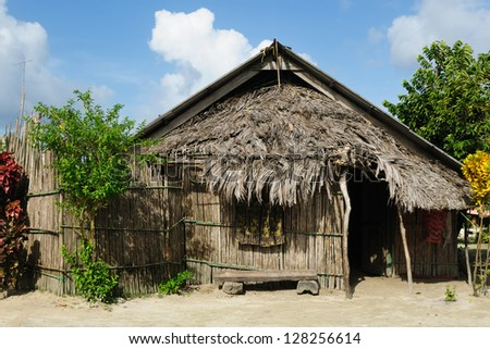 Panama, Traditional house kuna indians with the roof thatched on a Tigre island on the San Blas archipelago - stock photo