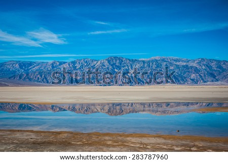 Panamint mountains reflected in the waters of Death Valley. - stock photo
