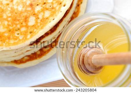 pancake and honey - stock photo