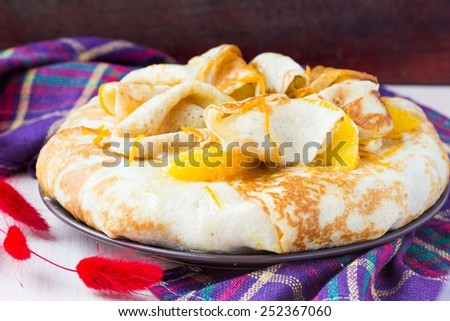 Pancake cake with oranges, whipped cream, delicious breakfast on Shrove Tuesday - stock photo