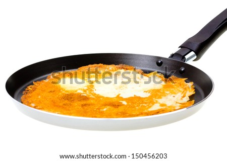 Pancake cooking in a pan isolated on white background