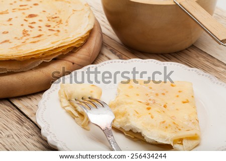 Pancake or crepe with cottage cheese. - stock photo