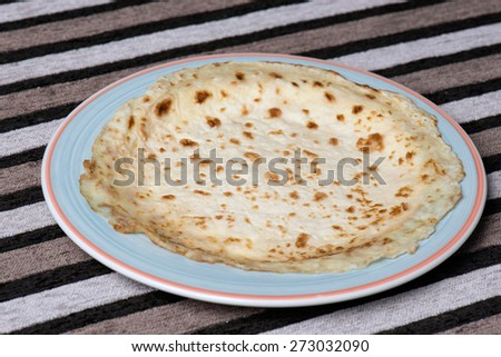 pancake or rooti flat on a plate - stock photo