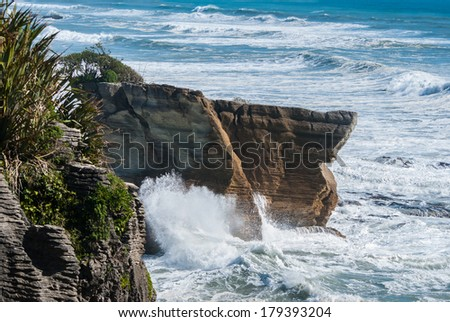 Pancake rock canyon at western coast in New Zealand's South Island - stock photo