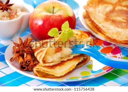pancake with homemade apple`s preserves and raisins for child - stock photo
