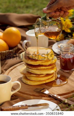 Pancake with honey. - stock photo
