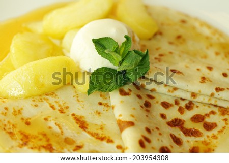 Pancake with ice cream and pear - stock photo
