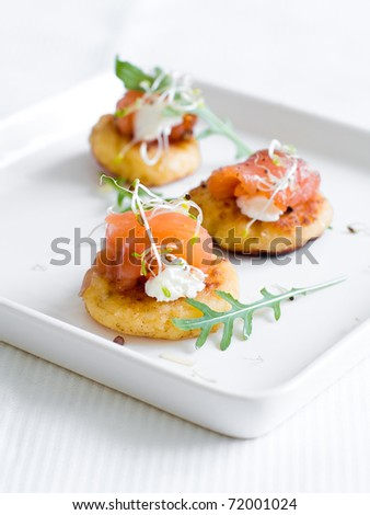 Pancake with smoked salmon, cream cheese and sprouts - stock photo