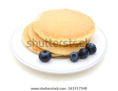 pancakes and blueberries on plate isolate on white  - stock photo