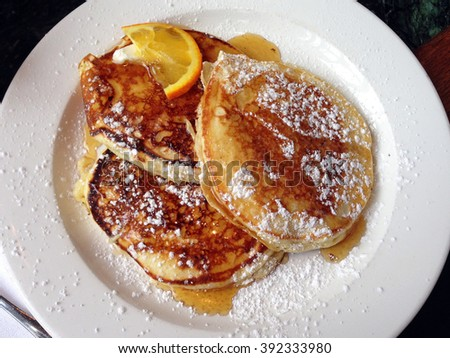 Pancakes and maple syrup, New York - stock photo