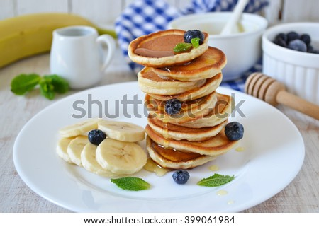 Pancakes for breakfast with honey and blueberries  - stock photo
