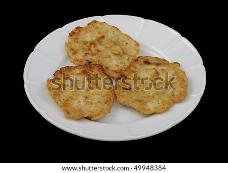 pancakes from matzo on plate with black background