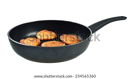 Pancakes in a frying pan. Isolated on white background.