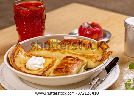 Pancakes in plate on wooden table
