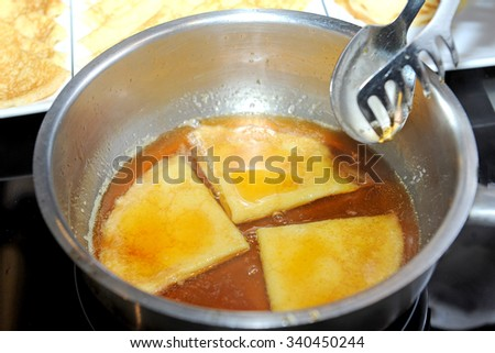pancakes in syrup - stock photo