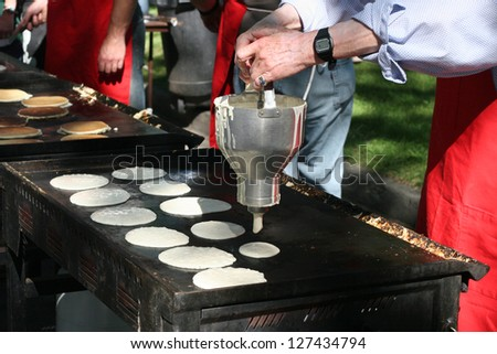 Pancakes in the making - stock photo