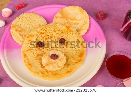 Pancakes in the shape of a bear face, a kid dessert - stock photo