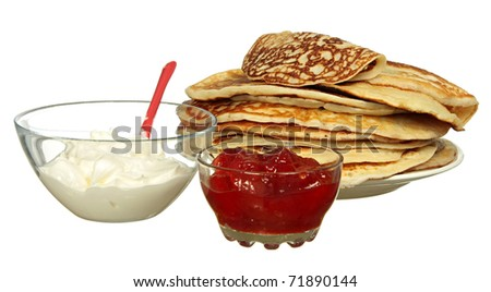 Pancakes, jam and bowl with sour cream isolated on a white background - stock photo