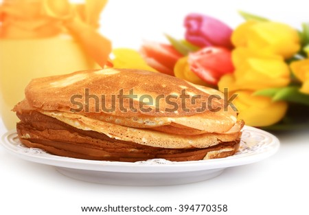 pancakes mango curd tulips on a white background - stock photo