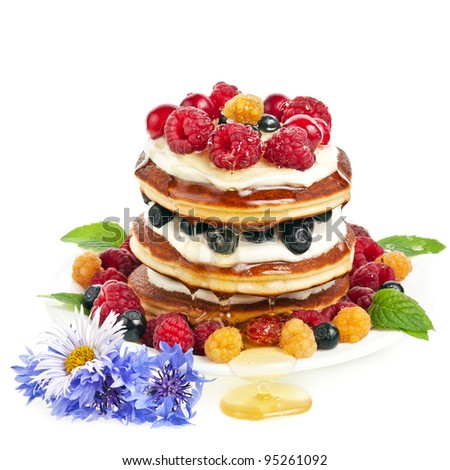 Pancakes stack with fresh berries and honey isolated on white background - stock photo