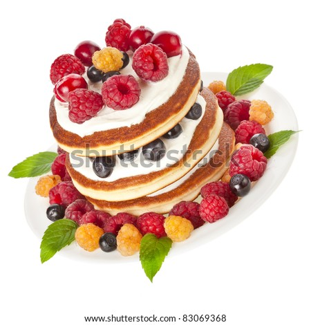 Pancakes stack with fresh berries  on white background